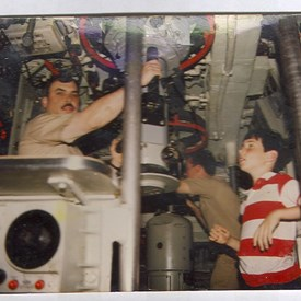 Even on a Nuc sub Bill takes time to work with his oldest son. This was taken at sea on a family & dependents cruise on USS Ben Franklin. Bill was the Captain of the ship.