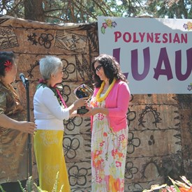 16th Annual Luau - Patsy presenting Ms. Christine Zemanek of Milgard Foundation with a very special APCC Award of Appreciation