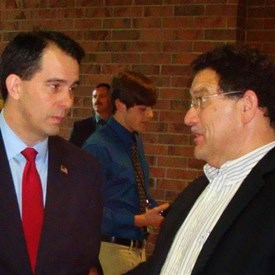 Bob Kulp speaking with Scott Walker.