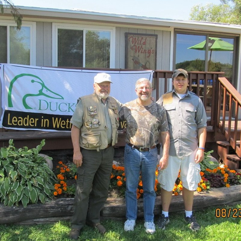Ducks Unlimited Sporting Clays fundraiser, August 23, 2013. Ken with Ducks Unlimited CEO, Dale Hall, and his grandson, Scott.