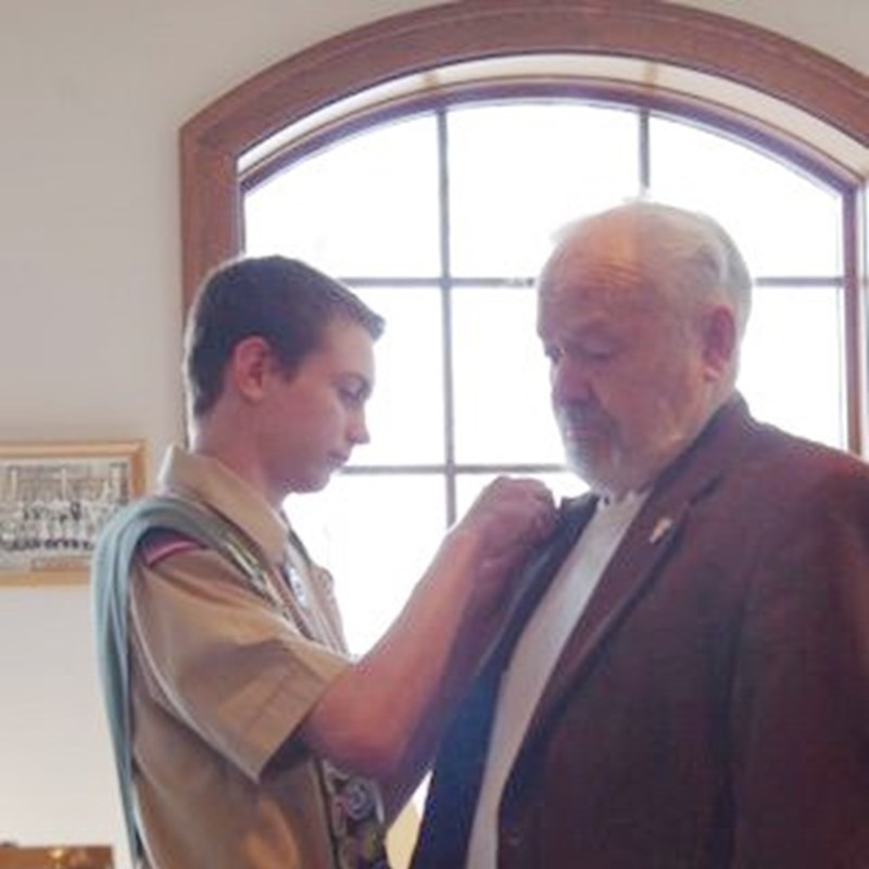 Eagle Scout Braden Schubring pinning Rep. Ken Skowronski with the BSA Best pin for all his works of kindness amongst Franklin Scouts.