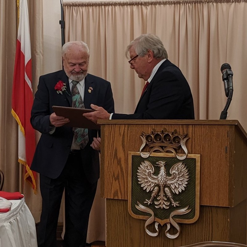 Milwaukee Society President Terry Witkowski honoring Rep. Skowronski as 2019 Polish American of the Year with presented the Outstanding American of Polish Descent plaque.