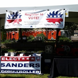 I thought it was humorous that the only political booth was put next to the bull... — at 2nd Annual Summer SausageFest.