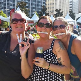 Three wonderfully spirited young ladies I couldn't resist not getting a picture. — at 2nd Annual Summer SausageFest.