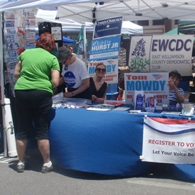 Folks shopping at the Taylor Zest Fest Dem booth.