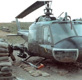 A UH-1C Charlie Model gunship in a protective revetment.