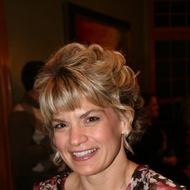 Kevin's high school sweetheart and wife of 20+ years, Dr. Jill Grant.  Kevin always said he married up!  :)