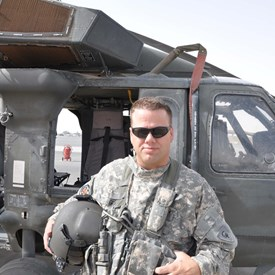 Captain Grant in front of his UH60 Helicopter