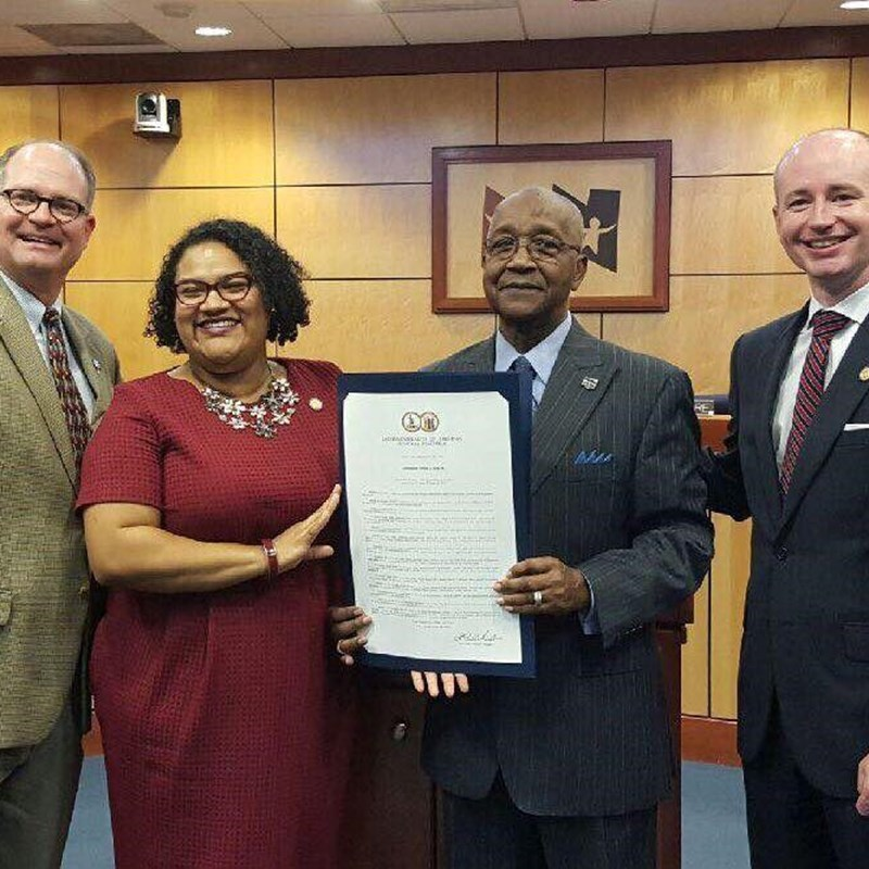 Presenting HJ1015 to Mr. Teddy Hicks to congratulate him on a wonderful career in public service at a Newport News School Board meeting with Senator Mason and Del. Mullin (93rd)