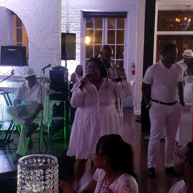 Giving welcoming remarks at The Group's All White Party to benefit the fight to end lupus