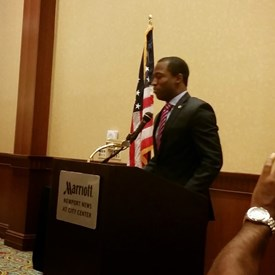 Levar Stoney, Secretary of the Commonwealth, giving greetings at Sen. Miller's breakfast in January