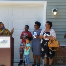 Giving welcoming remarks at a Habitat for Humanity ribbon cutting in the 95th District