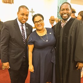 Justin Fairfax, Rev. Willard Maxwell, and me after service this summer