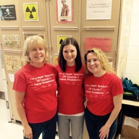 Carol and colleagues wear red to support public ed.