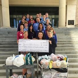 Dress down donation presented to James Storehouse 2018