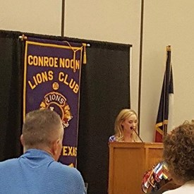 Announcing the guest speaker at Conroe Noon Lions Club.
