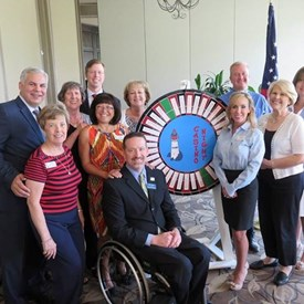 Sponsors of the North Shore Republican Women fundraiser taking picture with sponsor roulette wheel.