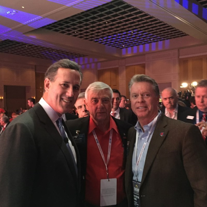 Walton County Republican Party Chairman Tim Norris and Walton County Republican Committeeman Bill Fletcher talk with GOP presidential candidate, Rick Santorum, at the RPOF Sunshine Summit in November 2015.