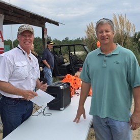 WCREC Chairman, Tim Norris, makes an announcement to participants at the 2015 Annual GOP Sporting Clay Tournament while Event Chairman and Sponsor, Lee Perry of Azland Mining LLC looks on.