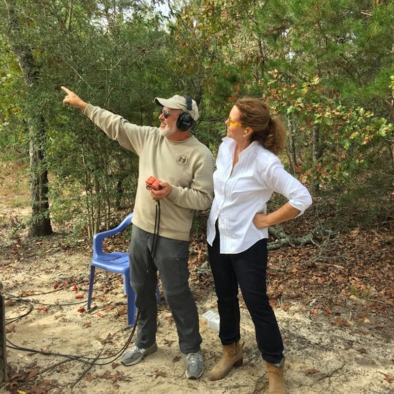WCREC member and GOP Sporting Clay Tournament volunteer, Bob Brooke, instructs WCREC Treasurer, Melanie Cissone, on the direction of the clay pigeons at his station.