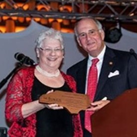 Representative Ted Davis, Jr. accepts his Community Champion Award from Elkin Mayor Lestine Hutchens, the League's outgoing president.