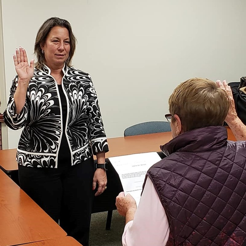 Cathy Antonelli being sworn in my Mary Ryman