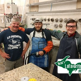 Owner of Mammoth Granite, Matt Hoffmeyer (left) and his son, Harrison (middle) taught me quite a bit about polishing, cutting, and designing the perfect granite counter tops right here in Escanaba!