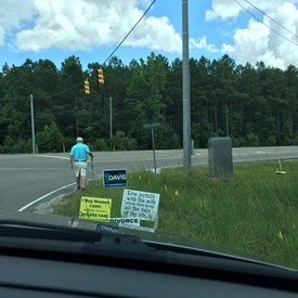 What devotion!  My husband putting out signs for me.
