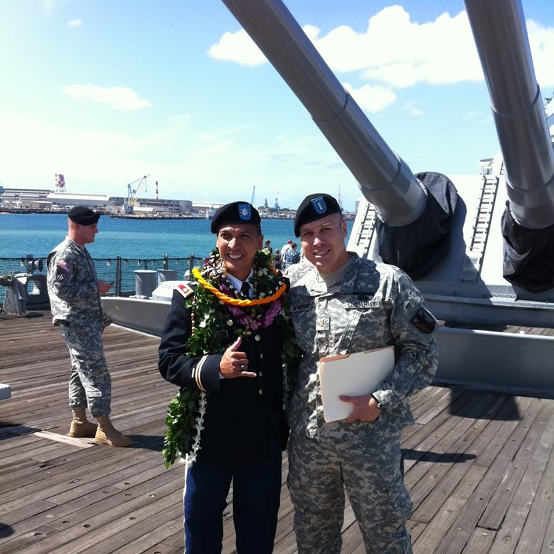 A great photo with Lieutenant Colonel Basto at the USS Missouri in Pearl Harbor Hawaii. During this day we got the chance to go into the ship's Captain's quarters.  The USS Missouri is the ship the Japanese surrendered on. The exact spot is just behind the big guns in the photo.