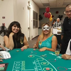 Attendees playing Baccarat