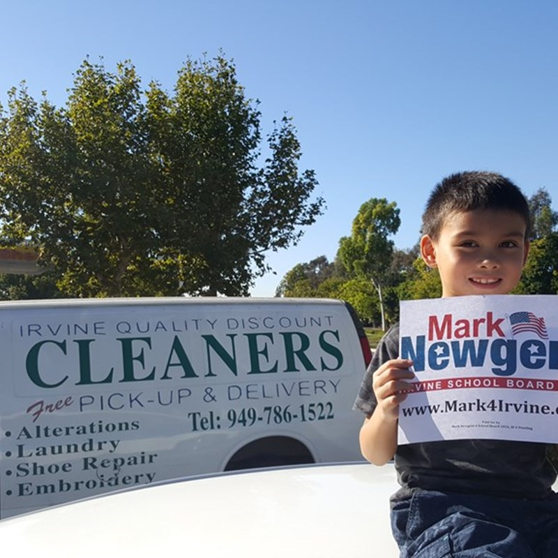 My son showing appreciation to Irvine Quality Discount Cleaners to be the first business to hang our signs.