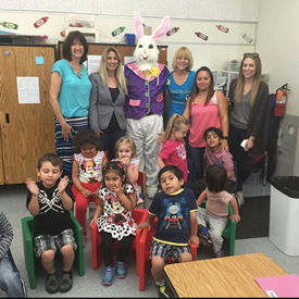 At Pleasant View at Easter time visiting preschool classrooms. Guess who is the bunny suit? It is principal Paul James!