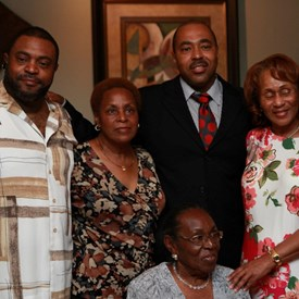 Drew with his brother Anthony, sisters Diane and Jackie (standing), and mother Lovie (seated) at Lovie's 80th birthday.