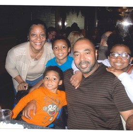 Here are Drew and Shelia with their grandchildren: Joie, James and Savannah.