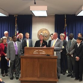 Rep. Deb speaking at House Minority Leader Darren Jackson's press conference on water quality, education, and redistricting