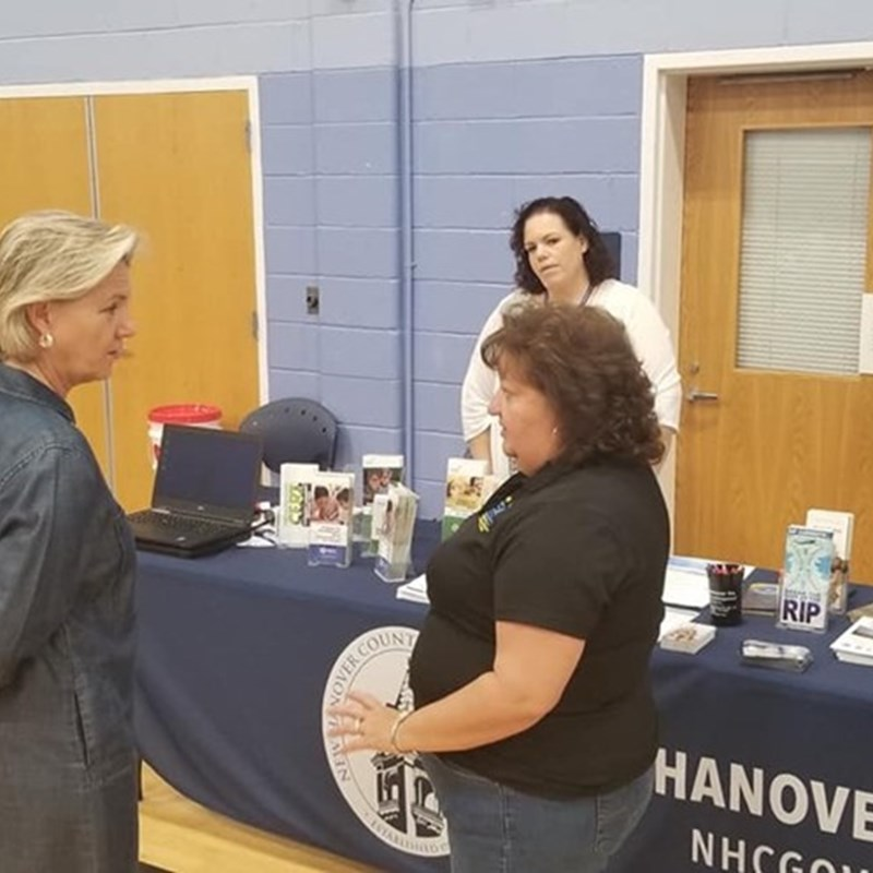 Representative Butler visits the Hurricane Preparedness Expo at the MLK Center. Seen here with a member New Hanover County's emergency operations team.
