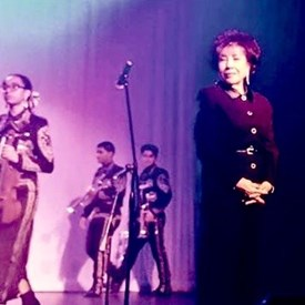 Gloria on stage during 5th Annual Noche de Navidad sponsored by Hispanic Association for Culture and Education (HACE). Uptown Theatre. Grand Prairie, TX. December 16, 2016.
