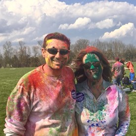 Joan B. Harris and Robert Mascia enjoying the festivities and joining in the colorful spirit of Holi!