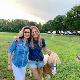Nancy Frank Cook and Sophia Chadda for Bernards Township Committee enjoying one of the miniature horses at National Night Out. Fun time was had by all!