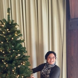Catherine Santaiti, BTDC secretary, fluffing the tree and adjusting the lights.