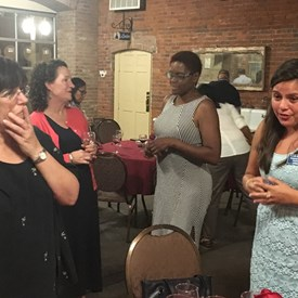 Shanel Robinson and Sara Sooy for Somerset County Freeholder talking with Bernards Township Democrats, Lisa Winter and Cindy Vega.