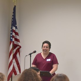 Chair Nancy D'Andrea greets members and guests at the BTDC April meeting.   Photo Credit: Betsy Bacot-Aigner