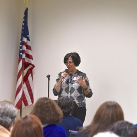 Treasurer Ana McCarthy reports to the BTDC at our April meeting.   Photo Credit: Betsy Bacot-Aigner