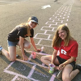 Took this photo on Saturday evening. These friends were still working on the squares! Great dedication! Kudos ladies!