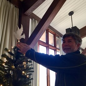 Matt placing the peace tree topper.