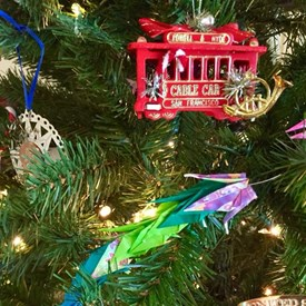 Garland made of origami paper cranes made by Bernards Township children and adults and a San Francisco cable car ornament!