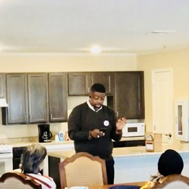 Fizer speaking to the residents of SageTree Terrace, concerning healthcare options.