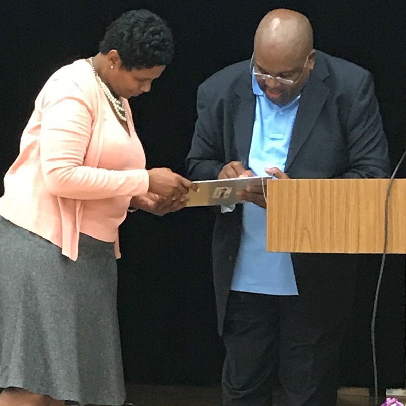 Fizer Campaign worker, Cathy Vallie getting the first signature from Pastor Michael Jones at Cathedral of Faith Church!