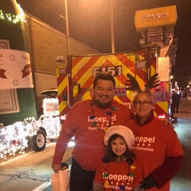Here walking in the Christie Clinic Parade of Lights with son Christopher Kloeppel and Granddaughter Molly and the Champaign County Young Democrats!