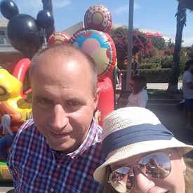 A selfie with my wife Victoria. Mickey is trying to photobomb us.